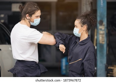 Professional mechanical employee of the car service handshake for agree and both looks happy and satisfied - Shutterstock ID 1873967872