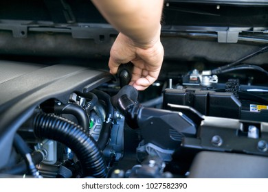 Professional mechanics  checking or fixing the engine of a modern car. mechanic performing maintenance and car maintenance.