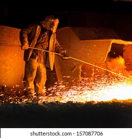 Professional Metallurgist Controls Before the Release of Iron Smelting. Steelmaker Burns Oxygen Opening for Producing of Cast-!ron from a High Furnace. Iron and Steel Metallurgical Plant.