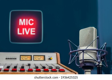 Professional microphone, audio console and on air sign in radio station studio