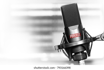 Professional microphone with podcast logo on a stand in radio studio