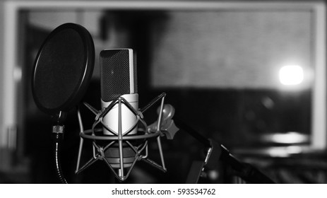 Professional Microphone in Recording Studio, Professional Studio monochrome Background with space for text