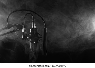 Professional Microphone in Recording Studio, Professional Studio. With Smoke, Black and White Photo