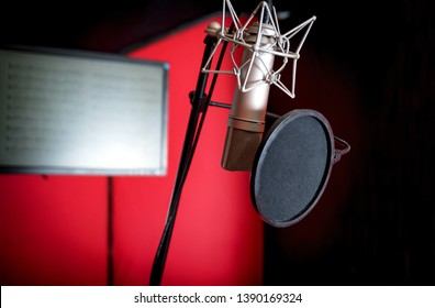 Professional microphone recording voice in music studio