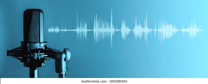 Professional microphone with waveform on blue background banner, Podcast or recording studio background - Shutterstock ID 1850285455