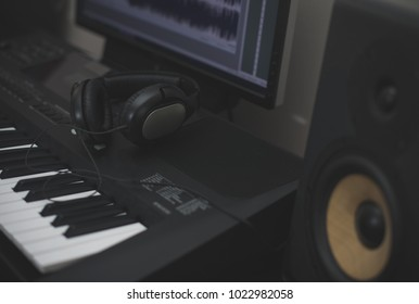 Professional monitors, headphones, midid keyboard and pc with music software.