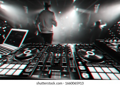 professional music controller DJ Board for mixing electronic music at night club party. Black and white photo with virtual reality glitch effect