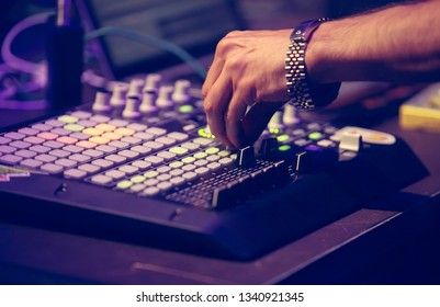 Professional music producer plays musical composition with modern midi controller device in sound recording studio.Musical production process for artists.Play and remix tracks with drum machine