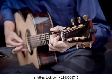 Professional musician With acoustic guitar.