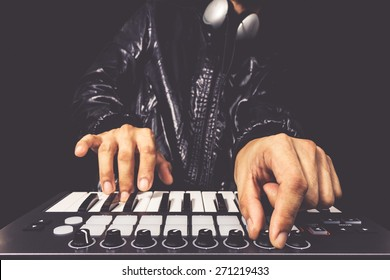 professional musician or DJ hands playing studio keyboard synthesizer, isolated on black for dance, groove, remix, underground background