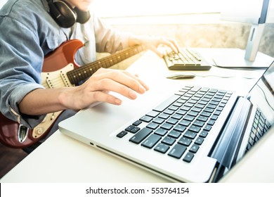 Professional musician recording electric guitar in digital studio at home, Music production technology concept
