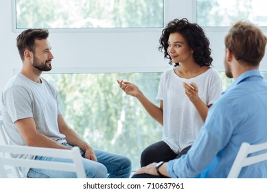Professional nice therapist looking at her patients