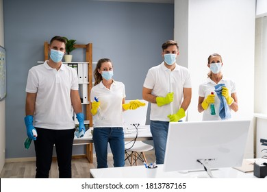 Professional Office Cleaning Janitor Team In Uniform And Face Masks