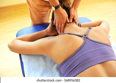 Professional osteopathy therapist treating young caucasian woman in day spa