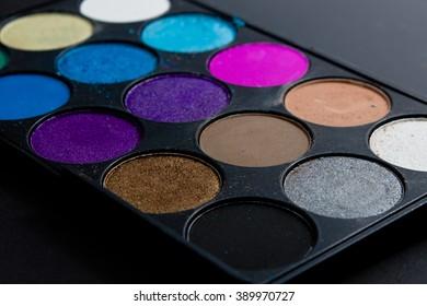 Professional pallet of eyeshadow. Multicoloured crumbled eye shadows.