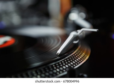 Professional party djs turn table.Analog stage audio equipment for concert in nightclub.Play & mix music tracks on vinyl records.Turntables needle cartridge scratches vinyl disc.DJ setup for festival