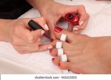 Professional pedicure master making pedicure in salon studio