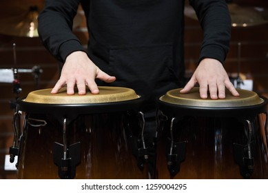 Professional percussion drum set closeup. Man drummer playing kongo percussion drums on the live music rock concert or in recording studio
