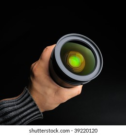 professional photo lens against black background