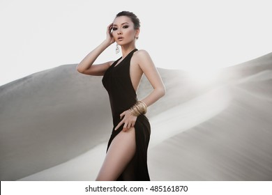 Professional photo shoot of beautiful sexy asian woman in desert