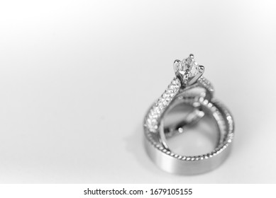Professional photograph of wedding rings on white background