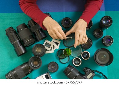 professional photographer cleaning lenses filters and camera. flat lay view