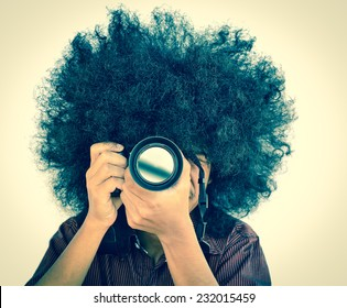 Professional Photographer take photo concept, Man with long hair and holding digital camera vintage style