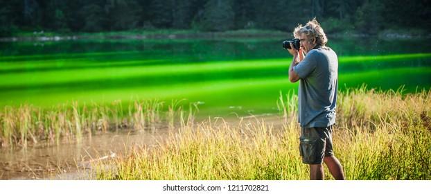Professional photographer take picture of landscape at the mountain lake. Zabljak, Durmitor, Montenegro