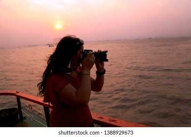 Professional photographer taking photographs. She is an Indian lady photographer which was captured her summer vacation memories in photograph.