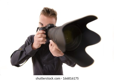 Professional photographer taking shoots with a telephoto lens