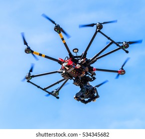 Professional photography drone with the camera flying