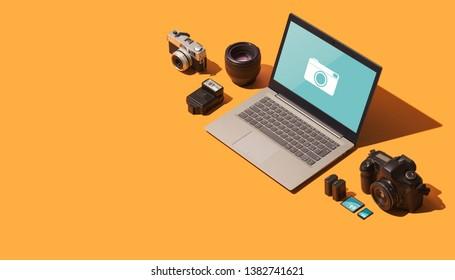 Professional photography equipment: digital reflex camera, memory cards, lens, flash light, batteries and laptop