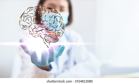The professional physician opens his hand and has a brain icon with sparkling light. Medical concept of neurology. Modern diagnosis innovation and treatment of diseases.