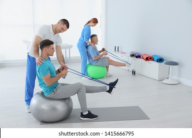 Professional physiotherapists working with patients in rehabilitation center