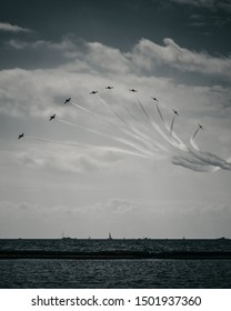 Professional pilots flying their fast jets in formation at the air show.