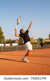 Professional player doing a tennis kick on court in the afternoon.
