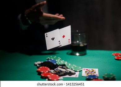 professional poker game. Green poker table with two games. poker player folds by throwing cards on the table