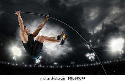 Professional pole vaulter training at the stadium in the evening. Sports banner. Horizontal copy space background - Shutterstock ID 1886280679