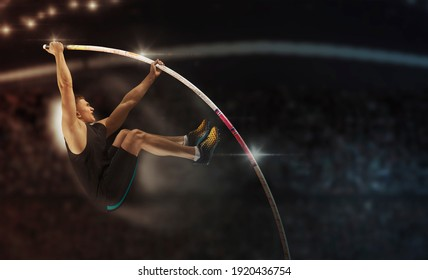 Professional pole vaulter training at the stadium in the evening. Sports banner. Horizontal copy space background - Shutterstock ID 1920436754
