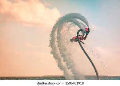 Professional pro fly board rider in tropical sea, water sports concept background. Summer vacation fun outdoor sport and recreation