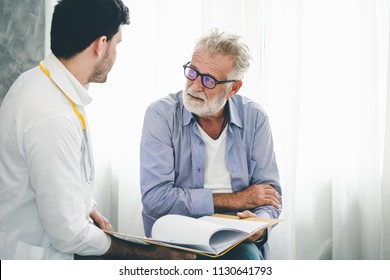 Professional psychologist doctor discussing with patient in therapy sessions at hospital room, Medical and Behavioral Health concept