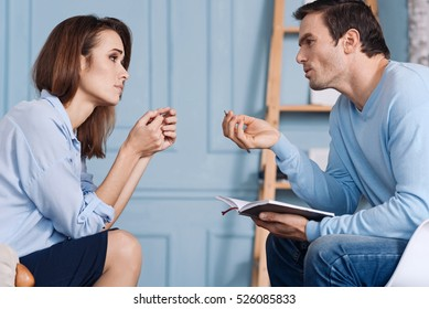 Professional psychologist talking with his client