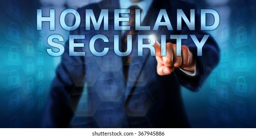 Professional pushing HOMELAND SECURITY on a touch screen. Business metaphor, security industry term and technology concept for the protection of a national territory, population and infrastructure.
