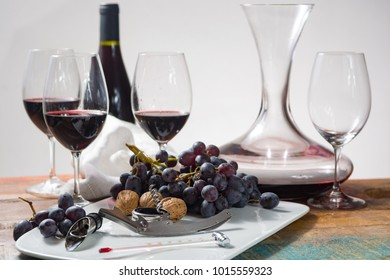 Professional red wine tasting event with high quality wine glasses and wine accessories close up