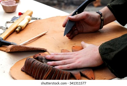A professional re-enactment craftsman making leather shoes like how it was done in the past