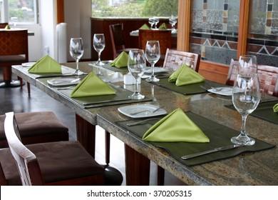 professional restaurant serving: table setting in luxury european restaurant, interior
