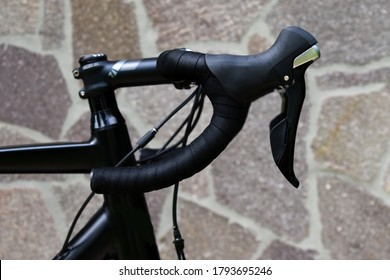Professional road bicycle handlebar from side with brake levers