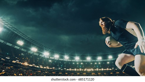 Professional rugby player runs with a ball on a professional sports arena with bleaches full of people. Arena and people on it are made in 3D.