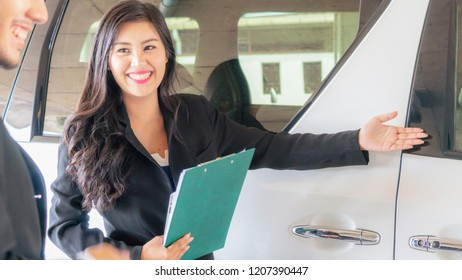 Professional salesperson woman selling white cars to business man buyer