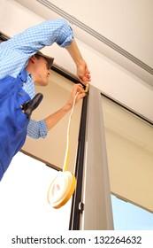 Professional sealing a window frame